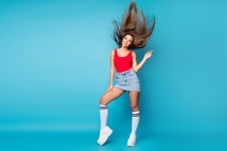 Full length photo of cute sweet lovely pretty girl enjoy spring free time weekend holiday trip her haircut fly air wind blow wear red tank-top footwear isolated over blue color background