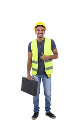 Full-length photo of electrical engineer wearing a denim t-shirt, jeans pants, shoes, yellow helmet and vest. He is making like sign while carrying a tools bag. Isolated on white background.