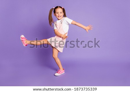 Full length photo of funky crazy girl dance cool wear pink dress white t-shirt isolated on violet color background
