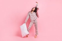 Full length photo of funky pretty young lady nightwear stretching dancing holding pillow isolated pink color background