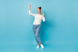 Full length photo of girl dance close eyes wear white sweater jeans footwear isolated blue color background