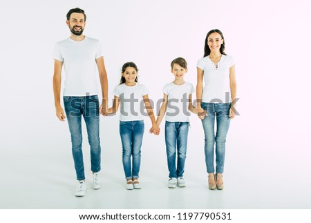 Full length photo of happy beautiful family isolated on white background in T-shirt