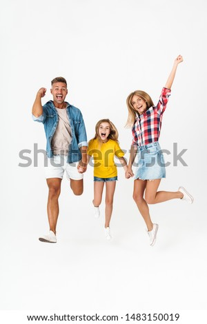 Full length photo of happy caucasian family woman and man with little girl laughing while having fun together isolated over white background