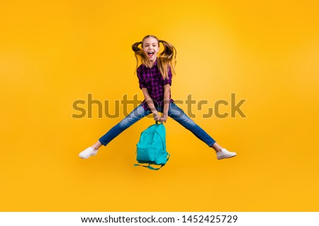 Full length photo of little pupil jump high finally holidays wear casual checkered shirt jeans denim isolated yellow background