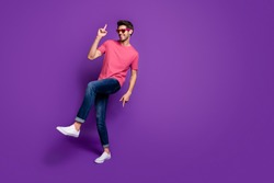 Full length photo of positive cheerful cool energetic guy music lover enjoy dance hip hop night club wear trendy clothes sneakers isolated over violet bright color background
