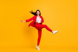 Full length photo of pretty classy girl dance open mouth wear red suit jacket trousers sneakers eyewear isolated yellow color background