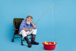 Full length photo of retired pensioner bored old man sit chair fish rod basin isolated on blue color background
