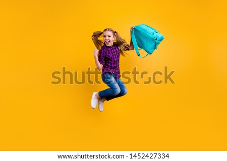 Full length photo of small pupil jump high finally holidays hooray wear casual checkered shirt jeans denim isolated yellow background