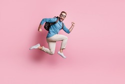 Full length photo of sweet funny man dressed blue sweater eyewear rucksack jumping parachute isolated pink color background