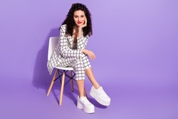 Full length photo of young attractive girl happy positive smile sit chair adorable gorgeous isolated over purple color background