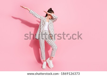 Full length photo of young woman dance make dab move enjoy party isolated over pastel color background Stockfoto ©