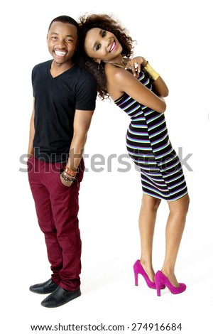 Full-Length Picture of Attractive African Couple Leaning Against Each Other in the Studio, Laughing, Isolated on White Background