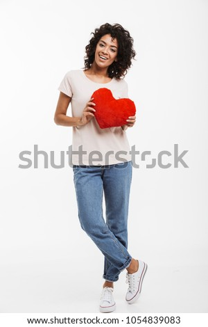 Full length picture of romantic adorable woman 20s with brown hair holding red paper heart in valentine day isolated over white background