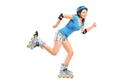 Full length portrait a smiling girl on rollers skating isolated on white background