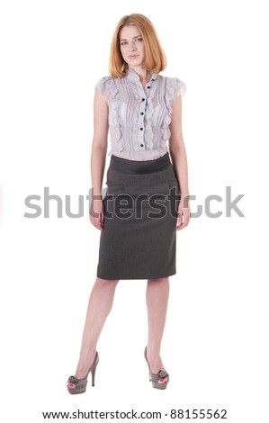 Full-length portrait beautiful lookind down young woman in blouse and skirt on white - stock photo