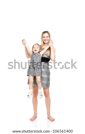 full length portrait happy mother hold little daughter smile looking at the camera isolated over white background, concept of togetherness family love 2 year cute girl child embrace