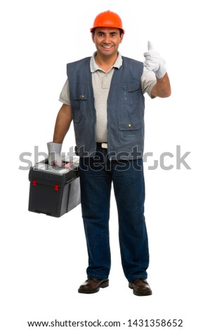 Full length portrait Isolated manual worker carrying a toolbox