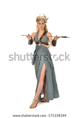 Full length portrait of a archer woman in green gown. inspired by roman and greek gods. standing pose, isolated on a white background.