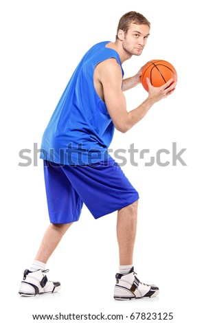 Full length portrait of a basketball player posing with a ball isolated against white background