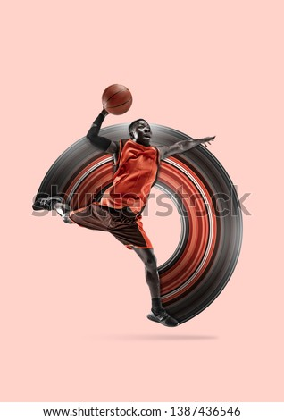 Full length portrait of a basketball player with a ball isolated on studio background. Fit african american athlete. Motion, activity, movement, advertising concept. Abstract design. Foto d'archivio ©