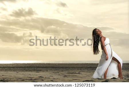 Full length portrait of a beautiful African American woman at the beach