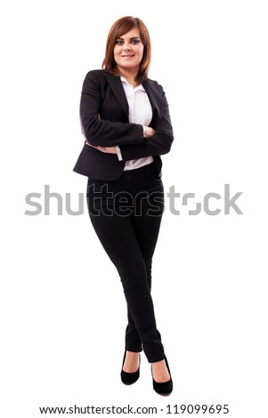 Full length portrait of a beautiful businesswoman standing with crossed arms and legs isolated on white background
