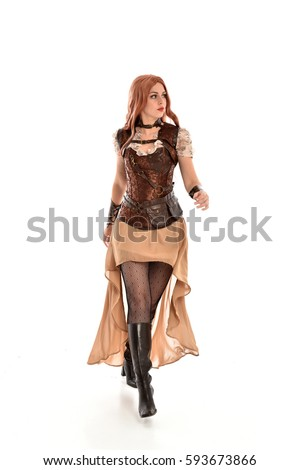 Stock Photo full length portrait of a beautiful girl wearing steampunk outfit, standing pose isolated on white background.