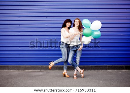 a5027d6c35 Full-length portrait of a beautiful mother with her daughter wearing blank white  t-