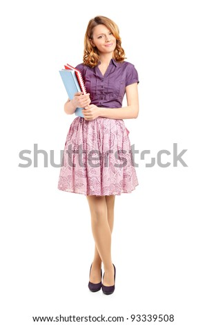 Full length portrait of a beautiful school girl holding books isolated on white background