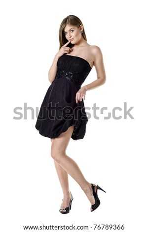 Full length portrait of a beautiful sexy girl in black dress. Isolated over white - stock photo