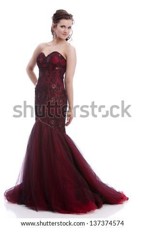 Full length portrait of a beautiful teen ready for prom.  Isolated on white.