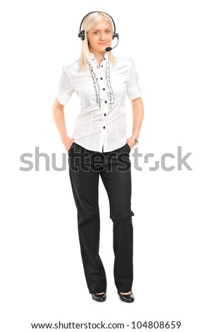 Full length portrait of a blond female customer service operator with headphones and microphone isolated on white background