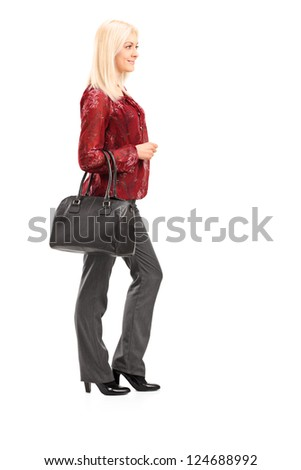 Full length portrait of a blond woman standing isolated on white background
