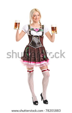 Full length portrait of a blond woman with traditional costume holding beer glasses isolated on white background
