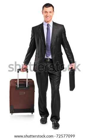 Full length portrait of a business traveler carrying a suitcase isolated against white background