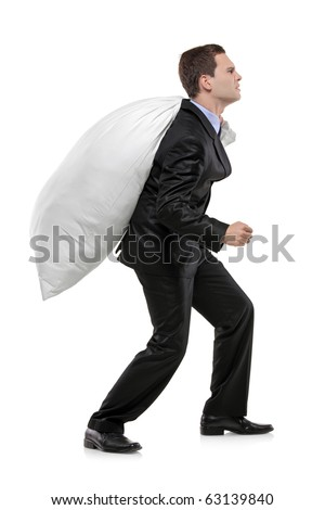 Full length portrait of a businessman carrying a money bag isolated against white background