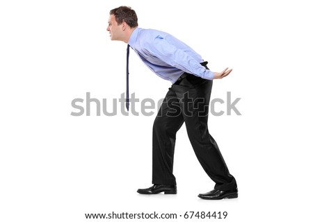 Full length portrait of a businessman carrying something imaginary isolated against white background - good for montage