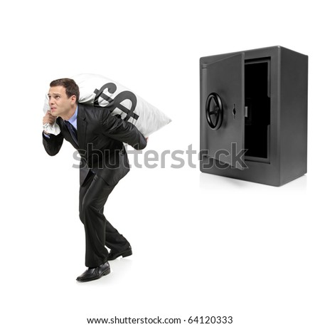 Full length portrait of a businessman stealing a money bag from a deposit safe isolated on white background