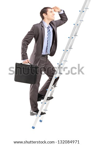 Full length portrait of a businessman with  briefcase climbing a ladder isolated on white background
