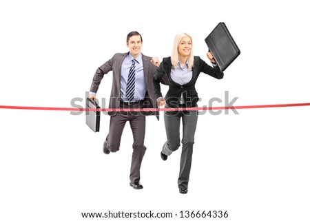 Full length portrait of a businesspeople running towards a finish line isolated on white background