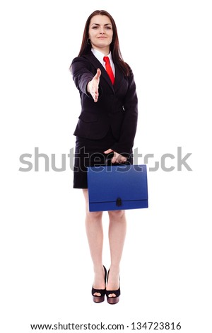 Full length portrait of a businesswoman giving hand for handshake isolated on white background