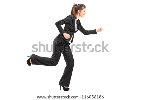 Full length portrait of a businesswoman in hurry running isolated on white background