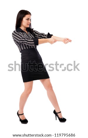 Full length portrait of a businesswoman pulling an imaginary rope isolated on white background