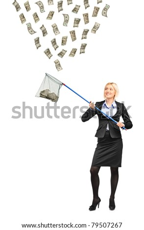 Full length portrait of a businesswoman with a fishing net trying to catch money isolated on white background - stock photo