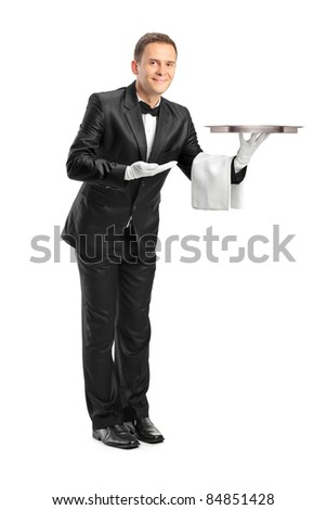 Full length portrait of a butler holding an empty tray isolated against white background