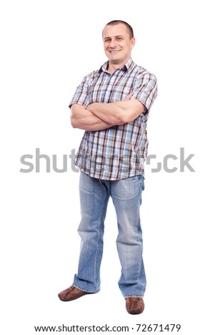 Full length portrait of a casual dressed young man isolated on white background