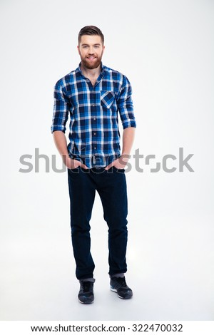 Full length portrait of a cheerful handsome man standing isolated on a white background