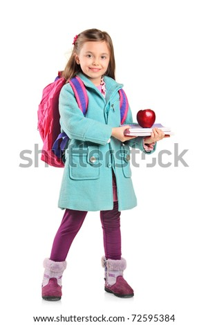 Full length portrait of a children holding books and apple isolated on white background