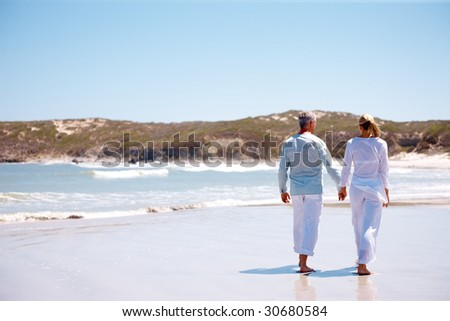 couple holding hands while