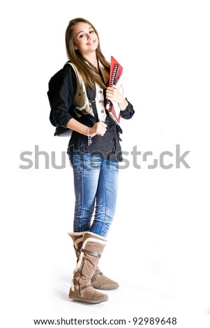 Full length portrait of a cute smiling young student girl.